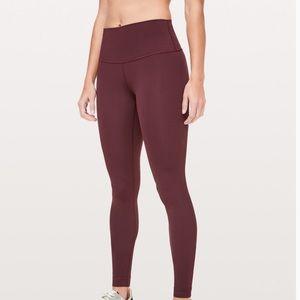 Purple Lululemon high wasted leggings.